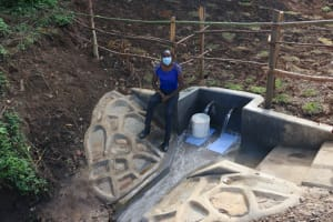 The Water Project: Silungai B Community, Tali Saya Spring -  Field Officer Lillian Achieng At The Spring