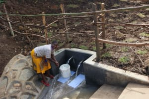 The Water Project: Silungai B Community, Tali Saya Spring -  Ruth Collecting Water
