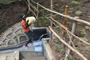 The Water Project: Silungai B Community, Tali Saya Spring -  Mounting Water On Her Head