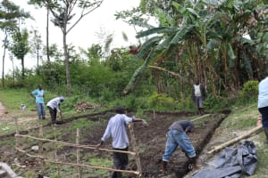 The Water Project: Lukala C Community, Livaha Spring -  Digging Cut Off Drainage