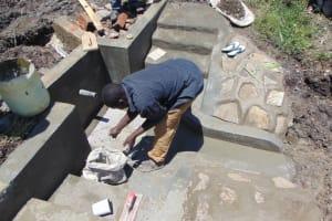 The Water Project: Lukala C Community, Livaha Spring -  Tile Setting