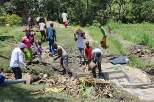 The Water Project: Lukala C Community, Livaha Spring -  Backfilling With Stones