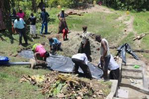 The Water Project: Lukala C Community, Livaha Spring -  Laying The Tarp