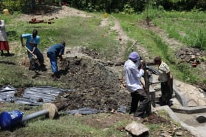 The Water Project: Lukala C Community, Livaha Spring -  Backfilling With Soil