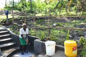 The Water Project: Lukala C Community, Livaha Spring -  Enjoying Clean Water
