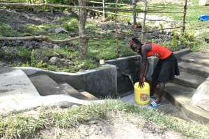 The Water Project: Lukala C Community, Livaha Spring -  Fetching Water