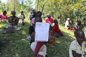 The Water Project: Lukala C Community, Livaha Spring -  Handout With Covid Information