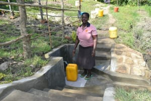 The Water Project: Lukala C Community, Livaha Spring -  Happy Collecting Clean Water