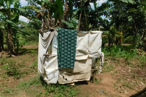 The Water Project: Muyundi Community, Magana Spring -  Bathing Shelter Made From Cement Sacks