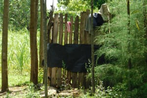 The Water Project: Muyundi Community, Magana Spring -  Bathing Shelter Made From Offcuts