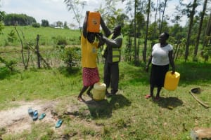 The Water Project: Muyundi Community, Magana Spring -  Carrying Water