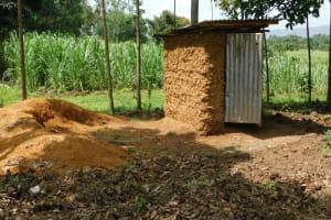 The Water Project: Muyundi Community, Magana Spring -  Latrine
