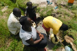 The Water Project: Muyundi Community, Magana Spring -  Community Members Fetching Water