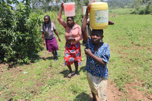The Water Project: Mukoko Community, Zebedayo Mutsotsi Spring -  Carrying Water