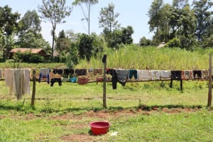 The Water Project: Mukoko Community, Zebedayo Mutsotsi Spring -  Fence As A Clothesline