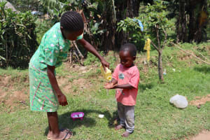 The Water Project: Shivagala Community, Alois Chiedo Spring -  Children Washing Hands