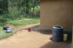 The Water Project: Shivagala Community, Alois Chiedo Spring -  Water Storage Outside