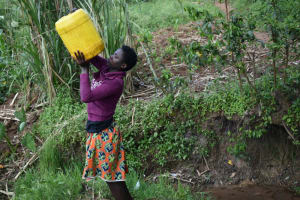 The Water Project: Malanga Community, Malava Housing Spring -  Mounting Water On Her Head