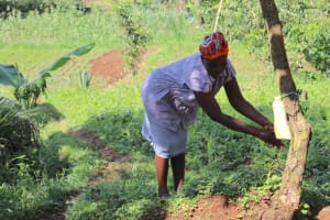 The Water Project: Shianda Community, Panyako Spring -  Handwashing At A Leaky Tin