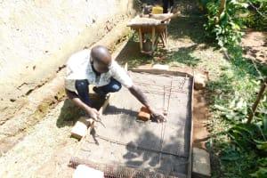 The Water Project: Emusaka Community, Muluinga Spring -  Sanitation Platform Construction
