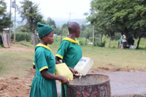 The Water Project: St. Peters Bwanga Primary School -  Students Bring Water For Construction