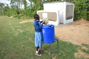 The Water Project: Isango Primary School -  Filling A Handwashing Station With Water