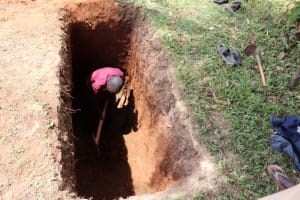 The Water Project: St. Peters Bwanga Primary School -  A Community Member Helps Dig The Latrine Pits