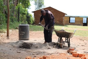 The Water Project: St. Peters Bwanga Primary School -  Mixing Cement And Sand For Construction