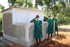 The Water Project: St. Peters Bwanga Primary School -  Girls Pose At Their New Latrines