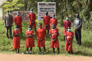 The Water Project: Mukambi Baptist Primary School -  Students And Staff At School Entrance