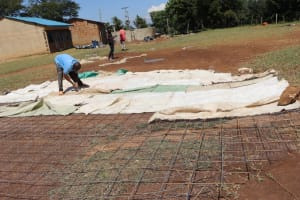 The Water Project: St. Peters Bwanga Primary School -  Sewing Sugar Sacks To Dome Frame