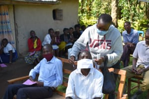 The Water Project: Emusaka Community, Muluinga Spring -  Fitting A Mask Made At Training To A Participant