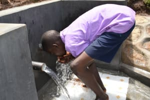 The Water Project: Mukhweso Community, Shemema Spring -  Enjoying A Fresh Drink