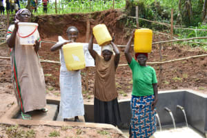The Water Project: Mukhweso Community, Shemema Spring -  Women Fetch Water At The Spring