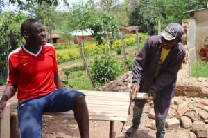 The Water Project: Jamulongoji Primary School -  Cutting Latrine Door
