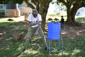 The Water Project: Isango Primary School -  Trainer David Show Correct Steps Of Handwashing