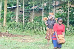 The Water Project: Emusaka Community, Muluinga Spring -  Community Members Deliver Bricks