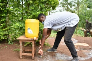 The Water Project: Mukhweso Community, Shemema Spring -  Trainer Julius Shows The Correct Steps Of Handwashing