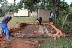 The Water Project: St. Peters Bwanga Primary School -  Setting Frame For Latrine Foundation