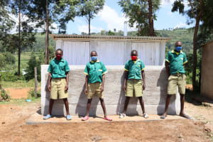 The Water Project: St. Peters Bwanga Primary School -  Boys Pose At Their New Latrines