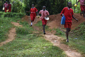The Water Project: Mukambi Baptist Primary School -  Rushing To The Spring To Fetch Water