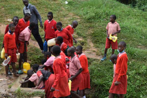 The Water Project: Mukambi Baptist Primary School -  Students Crowd At The Spring