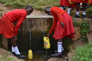 The Water Project: Mukambi Baptist Primary School -  Nelly And Her Friend Collecting Water