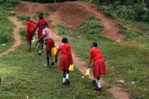 The Water Project: Mukambi Baptist Primary School -  Students Carrying Water From The Spring