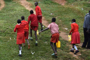 The Water Project: Mukambi Baptist Primary School -  Carrying Water