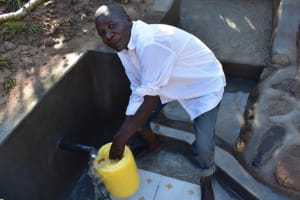 The Water Project: Emusaka Community, Muluinga Spring -  Fetching Water Easier Than Ever