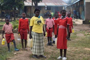 The Water Project: Mukambi Baptist Primary School -  Arriving Back At School With Water