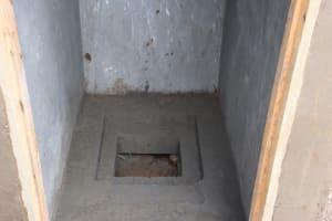 The Water Project: Jamulongoji Primary School -  Latrine Floor In Progress