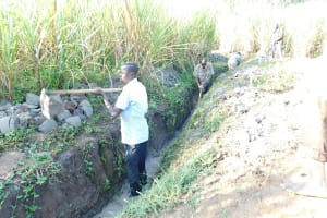 The Water Project: Emusaka Community, Muluinga Spring -  Deepening The Drainage Channel