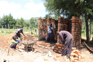 The Water Project: St. Peters Bwanga Primary School -  Latrine Brick Laying